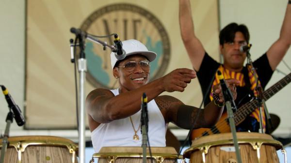 Vocalist and conguero Pedrito Martinez (center) performs with bassist Alvaro Benavides (right) at the 2012 Newport Jazz Festival.