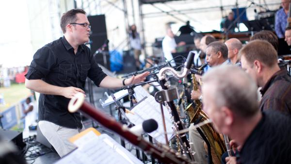 Ryan Truesdell conducts his Gil Evans Centennial Project onstage at the 2012 Newport Jazz Festival.