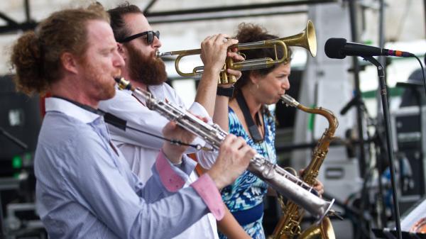 The Three Cohens — Anat (right), Avishai (trumpet, center) and Yuval (left) — perform at the 2012 Newport Jazz Festival.