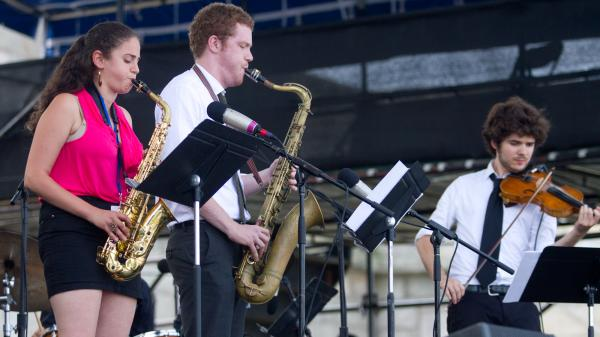 Saxophonists Lihi Haruvi (left) and Matthew Halpin (center) and violinist Alex Hargreaves  (right) of The Berklee Global Jazz Ambassadors perform at the 2012 Newport Jazz Festival.