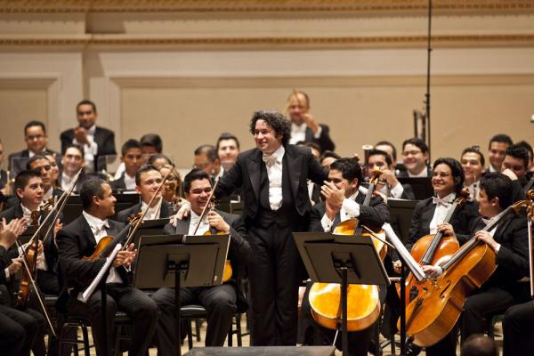 "Gustavo Dudamel takes a bow after conducting the Simón Bolívar Symphony. But the show wasn't over quite yet. He led the orchestra in three encores, ending in an ecstatic version of Leonard Bernstein's ""Mambo."" The composer's daughter Jamie Bernstein was in the hall."