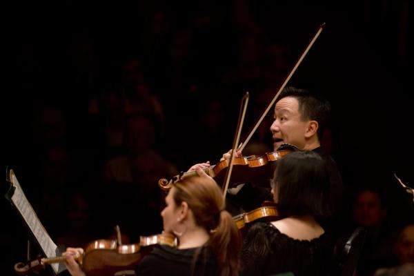 Concertmaster David Kim heads up the Philly string section with enthusiasm in Maurice Ravel's orchestral showpiece, <em>La Valse</em>.