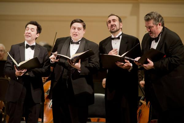 A barbershop-style quartet of singers — from left tenors Jorge Garza and Carl Moe, with baritones Anton Belov and Richard Zeller — played the collective role of Anna's family in Kurt Weill's <em>Seven Deadly Sins</em>.