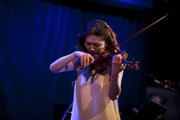 Violinist Jennifer Chun (and her sister Jennifer) joined for a performance of Muhly's <em>Honest Music</em>, a piece from 2002 originally for violin and prerecorded music.