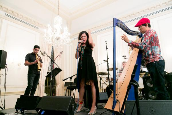 "One by one, guests joined harpist Edmar Castañeda (right) at the Americas Society. In ""Carrao Carrao,"" it's Dave Silliman and Andrea Tierra."
