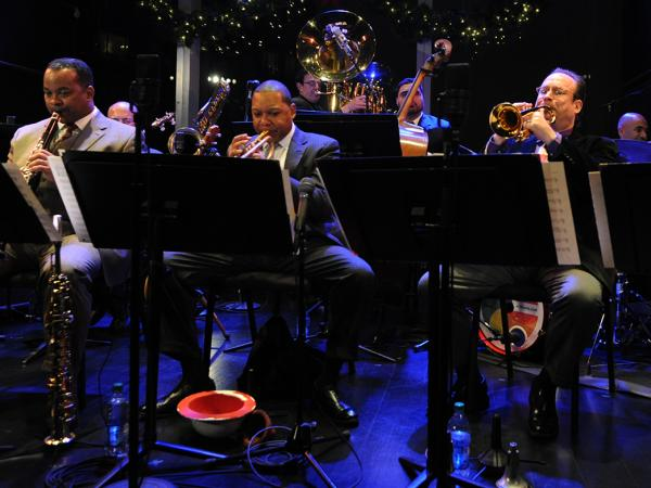 The Louis Armstrong Continuum on stage, with Wynton Marsalis just left of center. Co-leader Vince Giordano is on tuba in the back row.