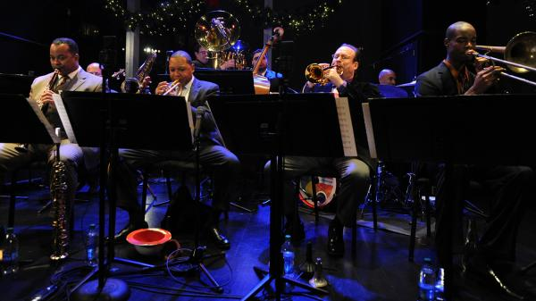 Louis Armstrong Continuum  on stage. Co-leader Vince Giordano is on tuba in the back row.