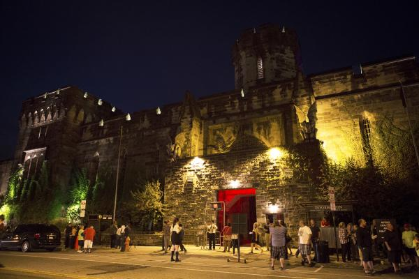 "Visitors wander near the entrance to ""Terror Behind The Walls."" The penitentiary lay dormant for 20 years until preservationists convinced the city to keep it as a historic site."