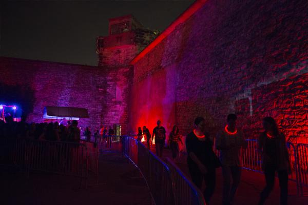 "Visitors, some with ""high-tech tracking devices,"" wait to enter the penitentiary. In 2011, the haunted attraction raised 63 percent of the historic site's operating budget."