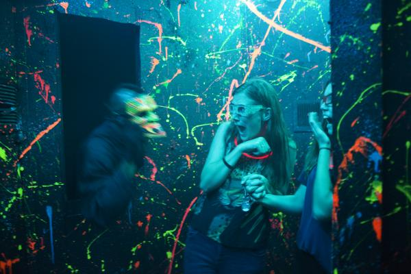 Taylor Vankooten (center) and Christina DuPree scream as an actor jumps out at them in 3-D. Vankooten and DuPree both work at the Halloween Haunt at Dorney Park in Allentown, Pa.