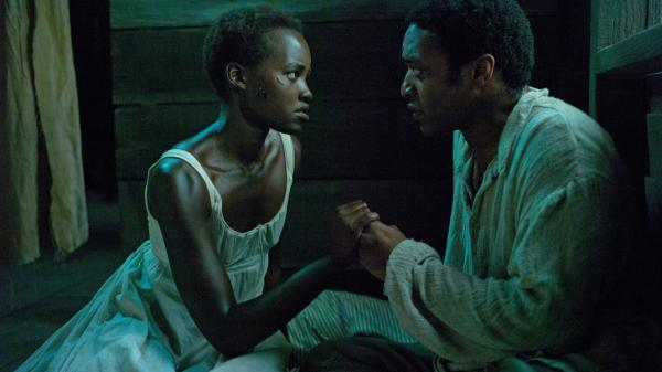 Lupita Nyong'o and Chiwetel Ejiofor play Patsey and Solomon, two slaves on a Louisiana plantation, in <em>12 Years a Slave</em><em>. </em>