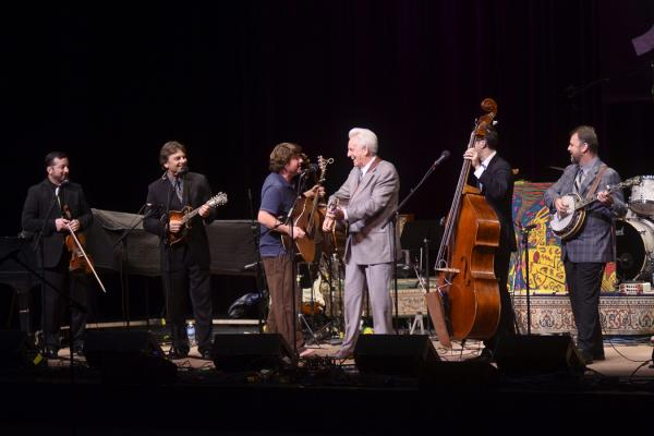 "Bluegrass legend Del McCoury (in gray suit) made a special appearance for the song ""Bumper Sticker."""