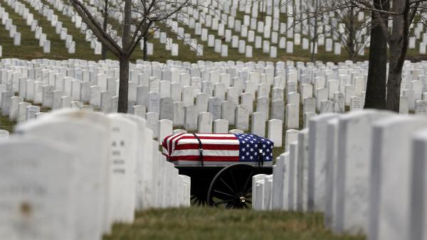 A flag-covered casket is taken to the burial site at the Arlington National Cemetery in March 2014. The cemetery has been filling up, despite expansions.