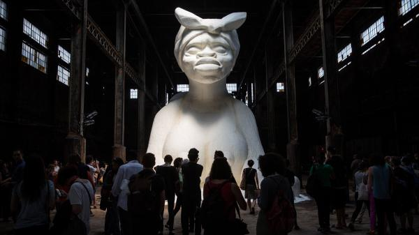"Viewers of Kara Walker's <em>A Subtlety</em> described the sculpture as ""beautiful"" and ""the American sphinx."" Another said, ""She is so exposed and she's so vulnerable, but at the same time she has some grace and majesticness that is completely unapproachable."""