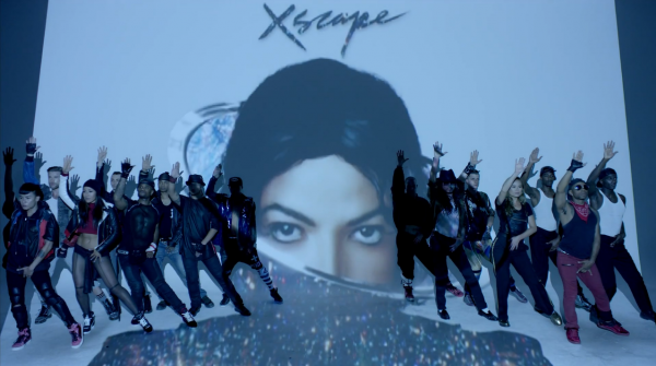 "Dancers pose reverently in the video for ""Love Never Felt So Good,"" the lead single from Michael Jackson's posthumous <em>Xscape</em> album."