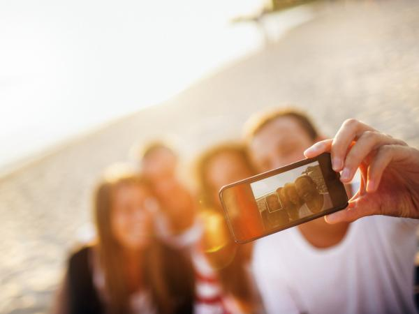 Selfie is one of the 150-plus new words added to Merriam-Webster's Collegiate Dictionary.
