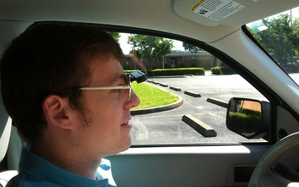 Wearing a bioptic telescope on his glasses, Dustin Jones, who is visually impaired, is able to drive.