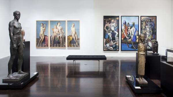 "Max Beckmann's biblical and political triptych <em>Departure</em> (right) hangs on the same wall as Adolf Ziegler's <em>Four Elements</em><em> </em>triptych, which Hitler owned. Both pieces are part of the Neue Galerie's ""Degenerate Art"" exhibit."