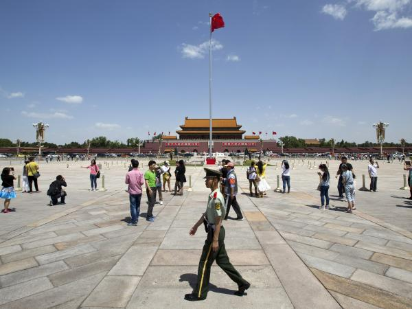 A paramilitary policeman patrols Tiananmen Square in Beijing on Tuesday. Vast numbers of Chinese are unaware of the violent crackdown on pro-democracy protesters that took place in and around the square in 1989.