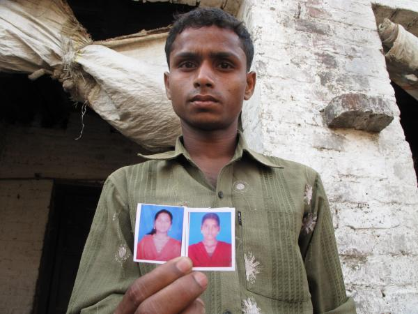 The gruesome gang rape and lynching of two young girls in northern India has sent shockwaves through the country and abroad. Vivendr Shakya, 21, brother of the younger victim, holds photos of both girls.