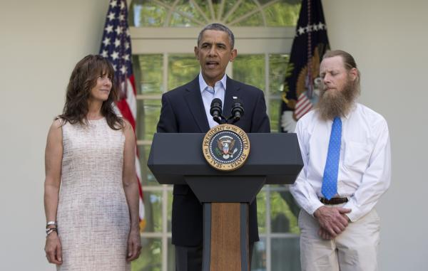 Bob and Jani Bergdahl, the parents of freed American soldier Bowe Bergdahl, with President Obama at the White House on Saturday. The controversy over Bergdahl's release could cast a long shadow over the administration.