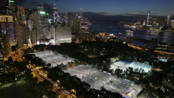 Tens of thousands of people attend a candlelight vigil at Victoria Park in Hong Kong on Wednesday to mark the 25th anniversary of the Chinese military crackdown on pro-democracy protests in Beijing.