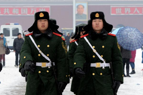 Chinese paramilitary police march at Tiananmen Square in Beijing during winter 2014.