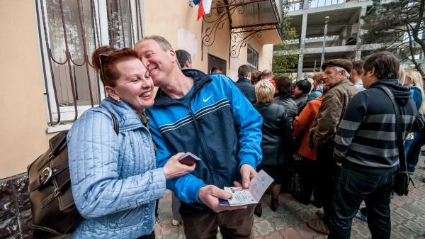 Crimean residents receive Russian passports in Simferopol, Crimea, on April 8. Russia seized the territory from Ukraine in February and annexed it in March. Tens of thousands of Crimea residents have obtained Russian passports since then.