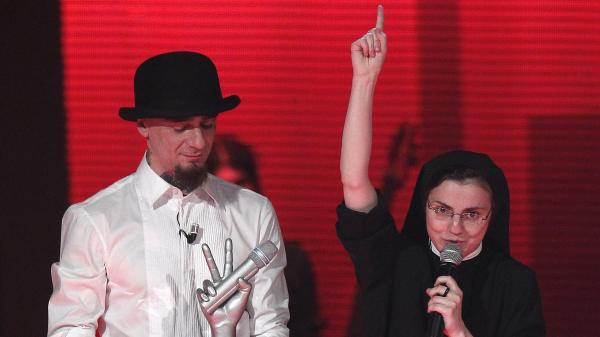 After winning Italy's version of <em>The Voice</em>, Sister Cristina Scuccia thanks God on stage in Milan alongside her coach, Italian rapper J-Ax.
