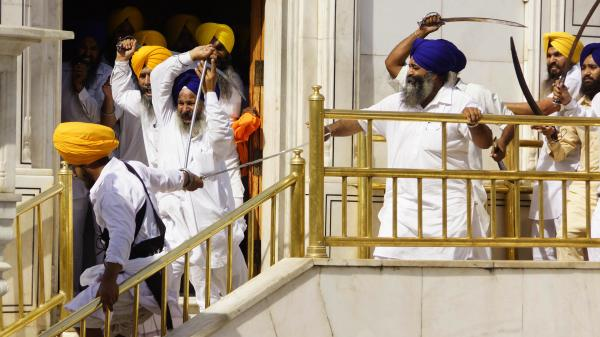 Members of a hardline Sikh group clash with guards of the Sikhs' holiest shrine, the Golden Temple, in Amritsar, India, Friday. At least 10 people were reportedly wounded in the clash.