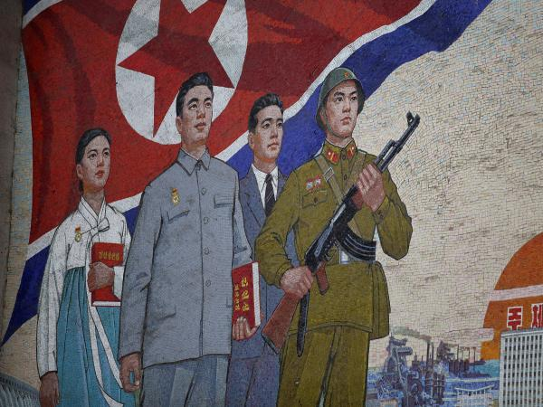 A propaganda painting is seen outside the People's Palace of Culture in Pyongyang, North Korea, in 2011. North Korean state media reported Friday that the nation has detained a U.S. tourist.