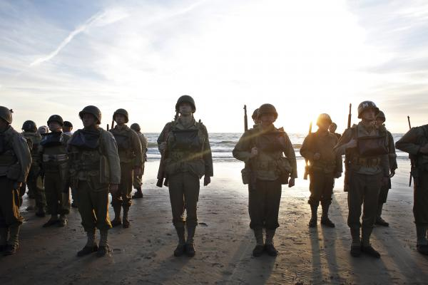 A group of military enthusiasts stand on Omaha Beach in Vierville sur Mer, western France, Friday. World leaders and dignitaries gathered to honor the more than 150,000 American, British, Canadian and other Allied troops who landed in Normandy on June 6, 1944, to defeat Adolf Hitler's Third Reich.