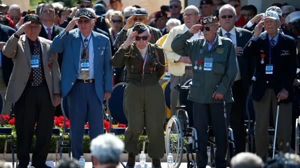 World War II veterans salute as taps is played at a ceremony Friday at the Normandy American Cemetery marking the 70th anniversary of D-Day in Colleville-sur-Mer, France.