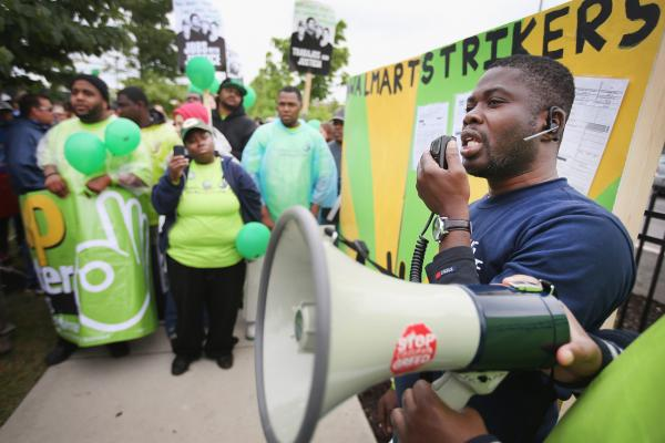 Walmart workers and union activists protest outside a Walmart store on June 4 in Chicago. Workers and activists were scheduled to hold strikes at Walmart stores in more than 20 cities today in their campaign to raise wages. The strikes are scheduled to draw attention to worker grievances before Walmart's annual shareholder meeting, taking place today in Fayetteville, Arkansas.  (Scott Olson/Getty Images)