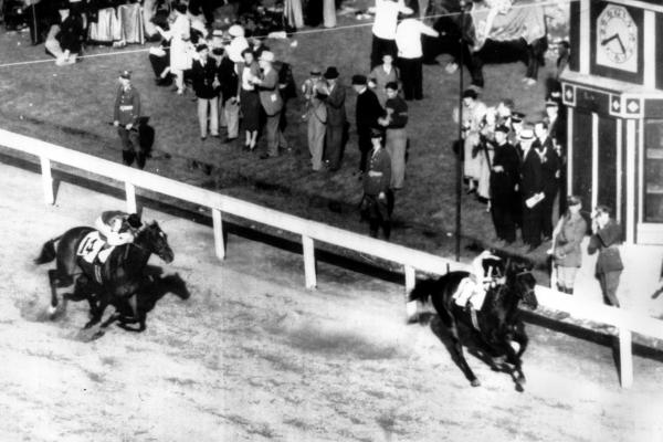 War Admiral wins the Kentucky Derby two lengths ahead of his challenger, Pompoon, in 1937.