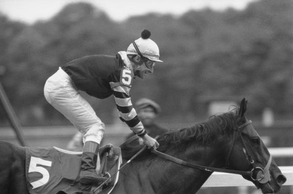 Jockey Jean Cruguet smiles after taking Seattle Slew across the finish line to win the 109th running of the Belmont Stakes and the Triple Crown in 1977. Seattle Slew led the race from the starting gate.