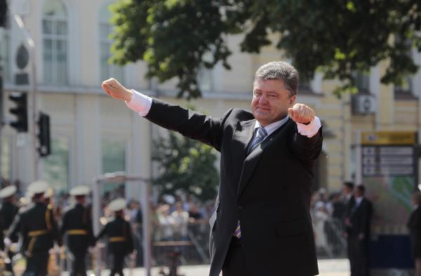 Ukrainian President Petro Poroshenko lifts his arms in greeting after the inauguration ceremony in Sophia Square in Kiev, Ukraine, on Saturday.