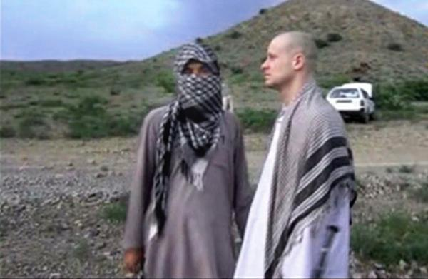 In this file image taken from video obtained from Voice Of Jihad Website, which has been authenticated based on its contents and other AP reporting, Sgt. Bowe Bergdahl (right) stands with a Taliban fighter in eastern Afghanistan.