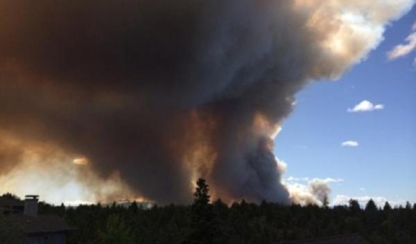 The Two Bulls fire burns near Pilot Butte on Sunday.