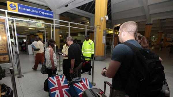 British tourists queue at a departure gate at Moi International Airport in the Kenyan coastal city of Mombasa, May 15. Hundreds of tourists were evacuated after Britain, the United States, Australia and France issued travel warnings for Kenya after a series of terrorist attacks.
