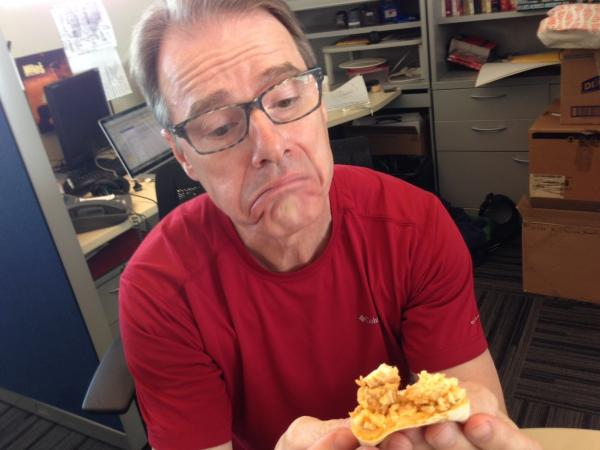 Robert and the quesadilla are making the same face.