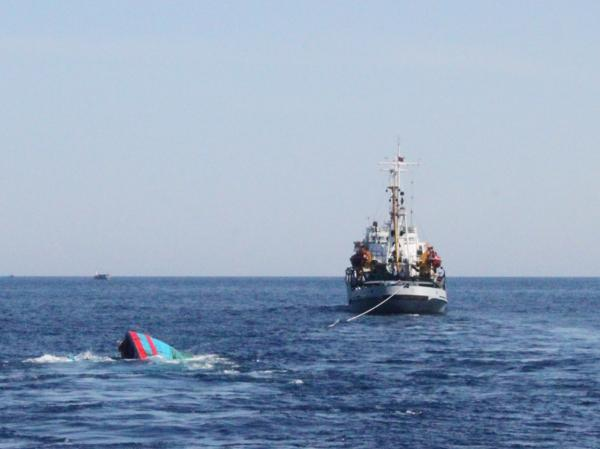 A Vietnamese boat nearly under water is being towed after it was reportedly rammed by Chinese vessels near disputed Paracel Islands, late last month.
