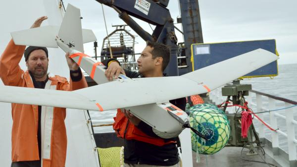 A 2011 photo shows an AeroVironment Puma drone being prepared for launch by University of Alaska researchers. The FAA says it approved BP's use of the drone to survey oil fields in Alaska.