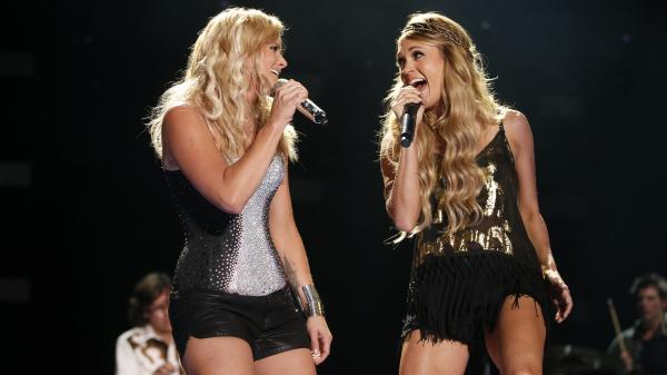 "During the CMA Festival in downtown Nashville, Miranda Lambert (left) welcomed Carrie Underwood for a duet on their hit ""Somethin' Bad."""