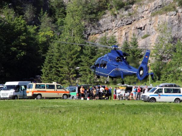 A helicopter lands at the bottom of Hochthron mountain in the Alps near Berchtesgaden, Germany, on Sunday, where rescuers were trying to extract a trapped researcher.