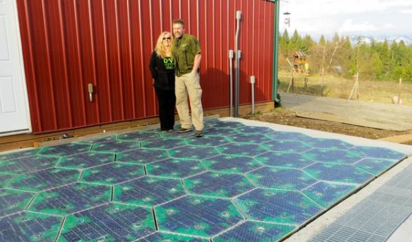 Scott and Julie Brusaw stand on a 12x12-foot parking lot, the first installation of their Solar Roadways project. The Brusaws hope to oneday pave over the nation's roadways with solar panels. They have raised more than $2 million on a crowdfunding site.