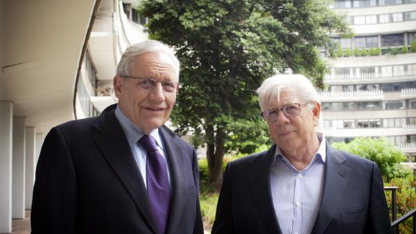 "Journalists Bob Woodward (left) and Carl Bernstein at the Watergate complex in Washington, D.C. Their reporting about the scandal later known as ""Watergate"" won a Pulitzer Prize."