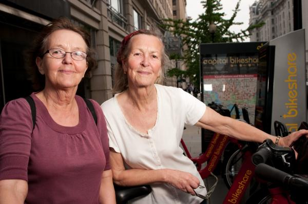 "Sisters Bia and Cia Rosenquist are from Finland and Belgium, where helmetless riding is common. ""We bike very carefully,"" Bia says. ""We were riding more slowly because we don't know the city."""