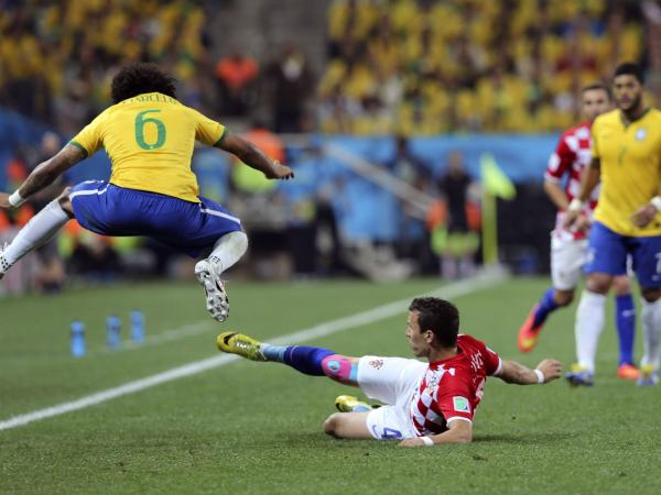 Marcelo (left) of Brazil and Ivan Perisic of Croatia in action during the FIFA World Cup 2014 group A preliminary round match between Brazil and Croatia at the Arena Corinthians in Sao Paulo, Brazil, on Thursday.