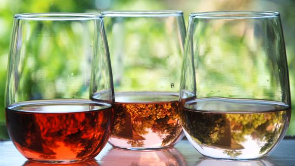 The intensity of the pink color of a rosé wine is determined by the length of time the grape juice has contact with the grape skin during the winemaking process. The wine on the left had the longest skin contact.